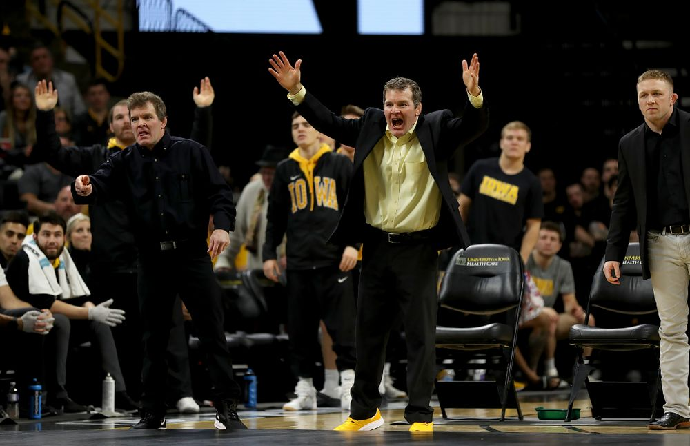 Iowa head coach Tom Brands and associate head coach Terry Brands work the sideline as Michael Kemerer wrestles Ohio State's Kaleb Romero at 174 pounds Friday, January 24, 2020 at Carver-Hawkeye Arena. Kemerer won the match 7-1. (Brian Ray/hawkeyesports.com)