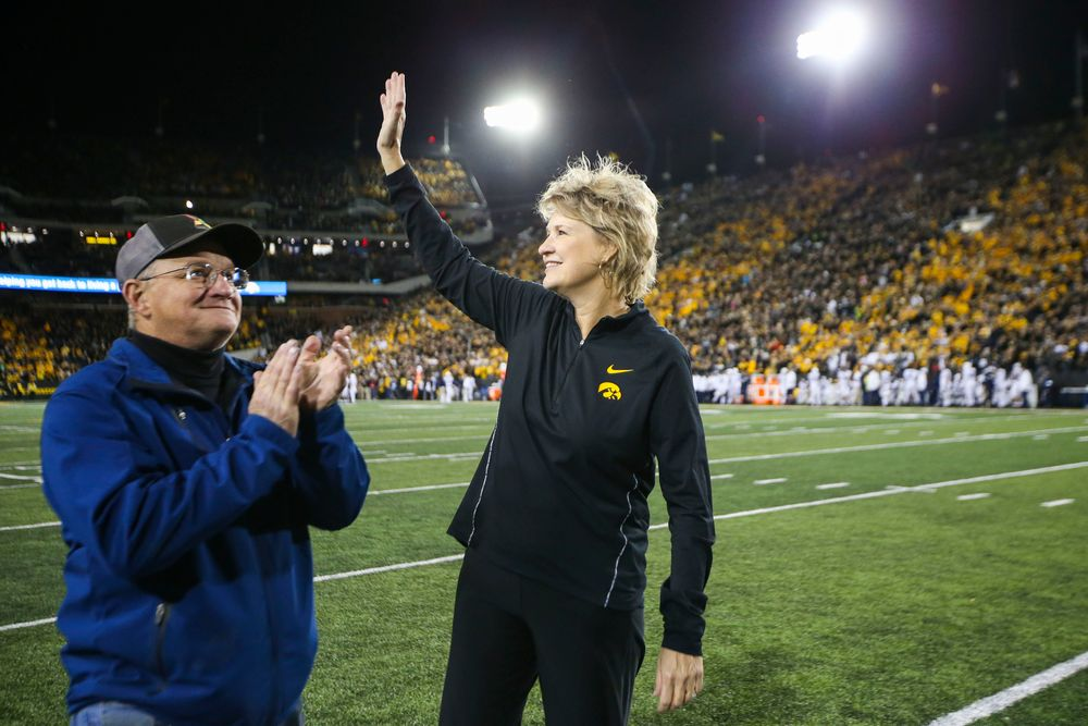 Iowa women's basketball head coach Lisa Bluder is recognized during Iowa football vs Penn State on Saturday, October 12, 2019 at Kinnick Stadium. (Lily Smith/hawkeyesports.com)