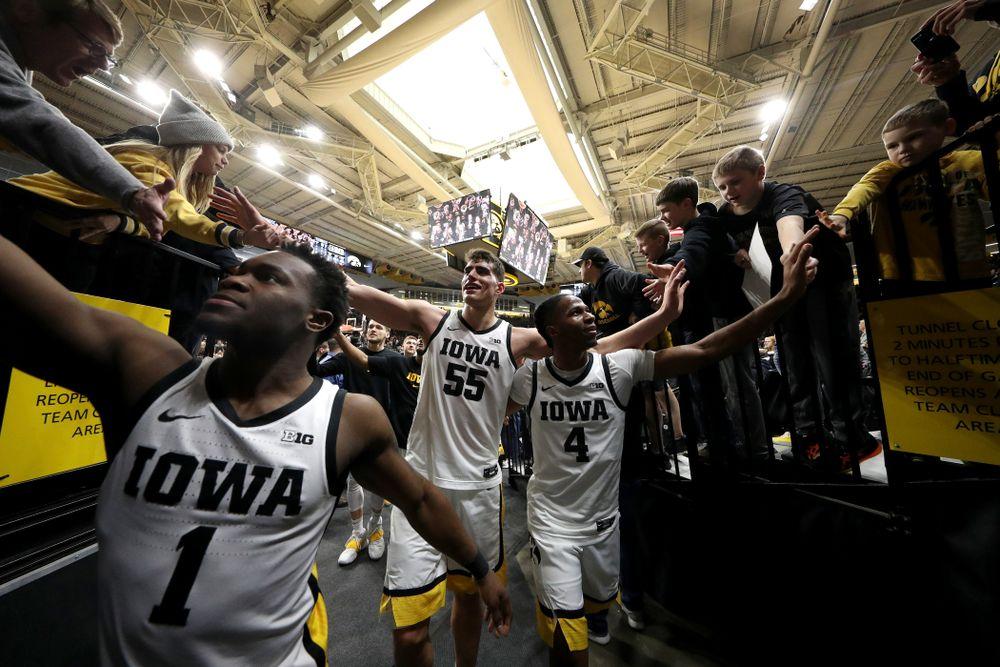Iowa Hawkeyes guard Joe Toussaint (1), forward Luka Garza (55), and guard Bakari Evelyn (4) celebrate their win against Penn State Saturday, February 29, 2020 at Carver-Hawkeye Arena. (Brian Ray/hawkeyesports.com)