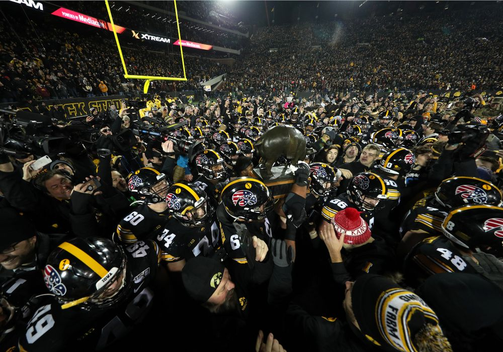 The Iowa Hawkeyes celebrate with the Floyd of Rosedale Trophy following their 23-19 victory over the Minnesota Golden Gophers Saturday, November 16, 2019 at Kinnick Stadium. (Brian Ray/hawkeyesports.com)