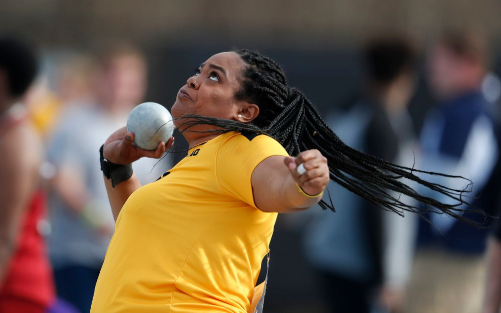 Iowa's Iowa's Laulauga Tausaga  competes in the shot put during the 2018 MUSCO Twilight Invitational  Thursday, April 12, 2018 at the Cretzm