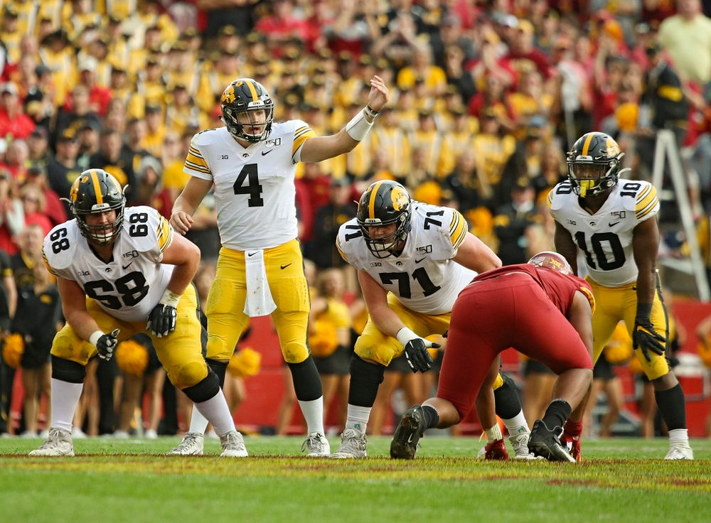 Iowa Hawkeyes quarterback Nate Stanley (4) motions at the line during the second quarter of their Iowa Corn Cy-Hawk Series game at Jack Trice Stadium in Ames on Saturday, Sep 14, 2019. (Stephen Mally/hawkeyesports.com)
