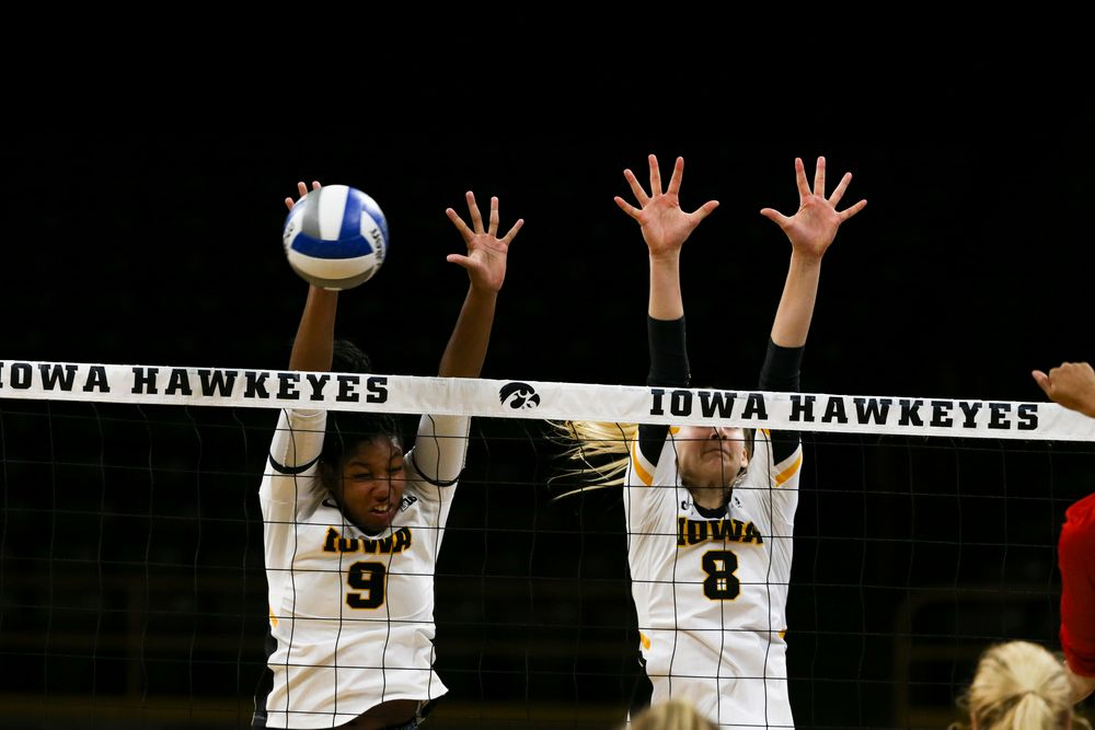 Iowa Hawkeyes middle blocker Amiya Jones (9) and Iowa Hawkeyes outside hitter Kyndra Hansen (8) during Iowa volleyball vs Maryland on Saturday, November 30, 2019 at Carver-Hawkeye Arena. (Lily Smith/hawkeyesports.com)