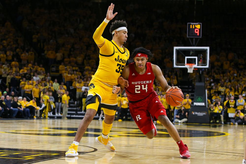 Iowa Hawkeyes forward Cordell Pemsl (35) defends against Rutgers guard Ron Harper Jr. during the Iowa men's basketball game vs Rutgers on Wednesday, January 22, 2020 at Carver-Hawkeye Arena. (Lily Smith/hawkeyesports.com)