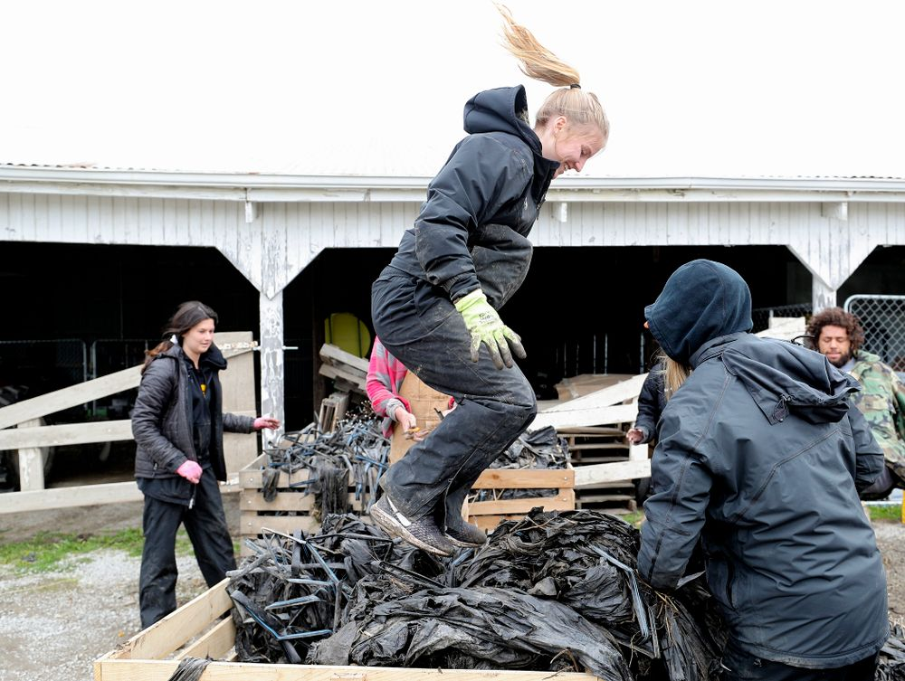 Iowa soccer players work at Grow: Johnson County at the Johnson County Historic Poor Farm during the 21st annual ISAAC Hawkeye Day of Caring in Iowa City on Sunday, Apr. 28, 2019. (Stephen Mally/hawkeyesports.com)