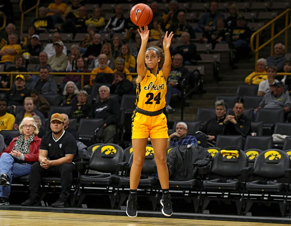 Iowa guard Gabbie Marshall (24) makes a 3-pointer during the second quarter of their game against Winona State at Carver-Hawkeye Arena in Iowa City on Sunday, Nov 3, 2019. (Stephen Mally/hawkeyesports.com)