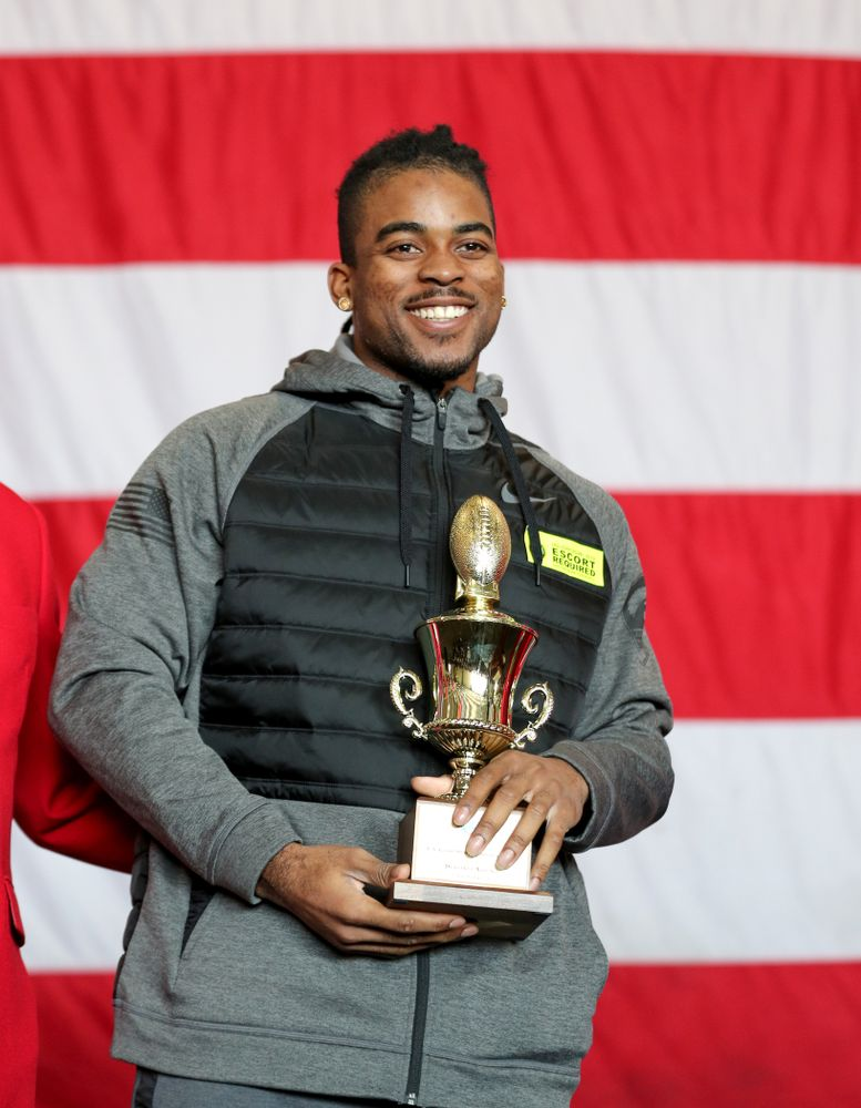 Iowa Hawkeyes defensive back Devonte Young (17) revives the U.S. Grant Sharp AdmiralÕs Trophy during tour of the USS Theodore Roosevelt (CVN-71) Tuesday, December 24, 2019 at the Naval Base Coronado. (Brian Ray/hawkeyesports.com)
