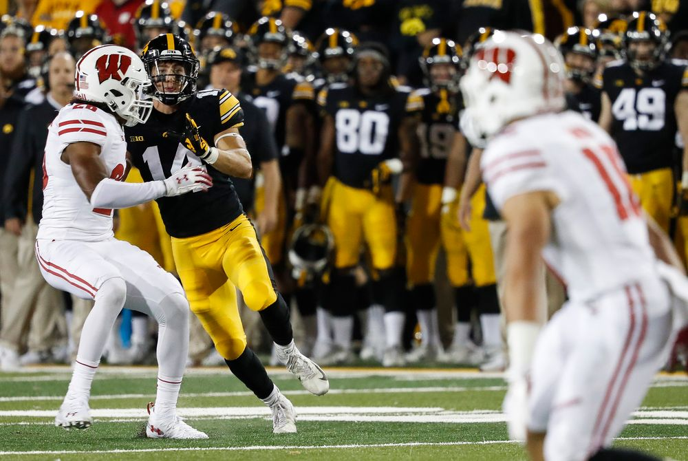 Iowa Hawkeyes wide receiver Kyle Groeneweg (14) runs downfield on punt coverage during a game against Wisconsin at Kinnick Stadium on September 22, 2018. (Tork Mason/hawkeyesports.com)