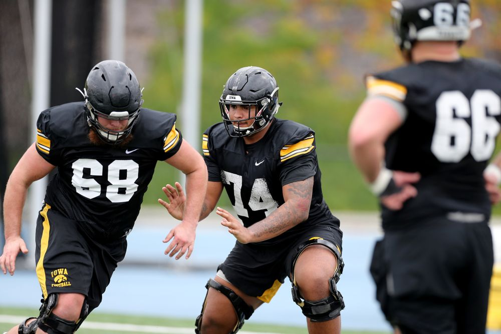 Iowa Hawkeyes offensive lineman Tristan Wirfs (74) works a drill with offensive lineman Landan Paulsen (68) during practice Sunday, December 22, 2019 at Mesa College in San Diego. (Brian Ray/hawkeyesports.com)