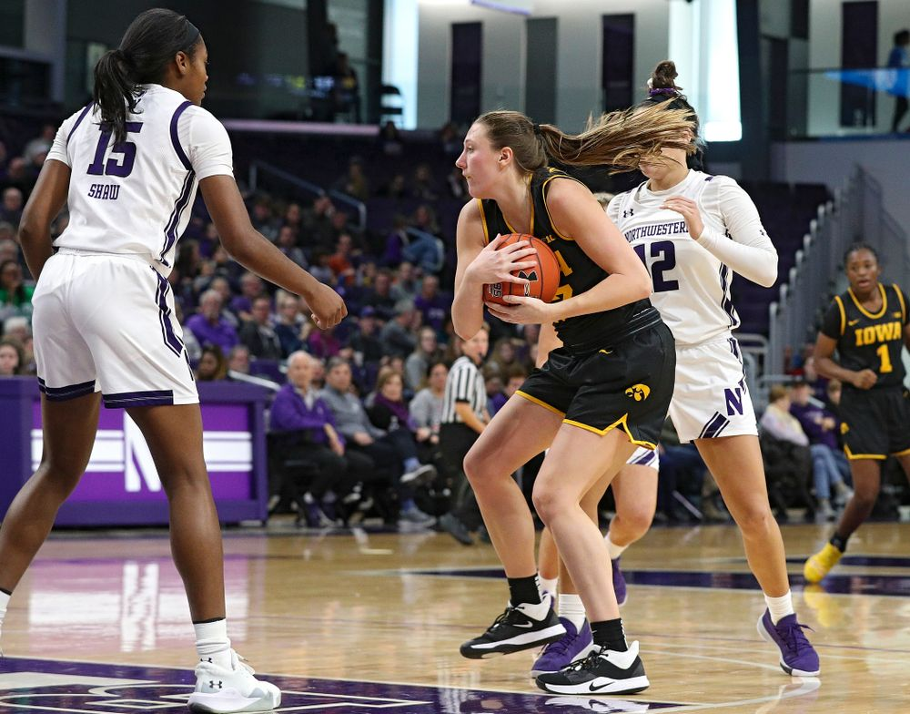 Iowa Hawkeyes forward Amanda Ollinger (43) grabs an offensive rebound during the third quarter of their game at Welsh-Ryan Arena in Evanston, Ill. on Sunday, January 5, 2020. (Stephen Mally/hawkeyesports.com)