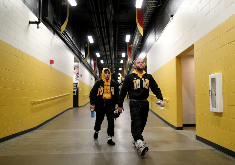 Iowa Alex Marinelli and Austin DeSanto walk to the mat for their meet against WisconsinÕs Sunday, December 1, 2019 at Carver-Hawkeye Arena.
