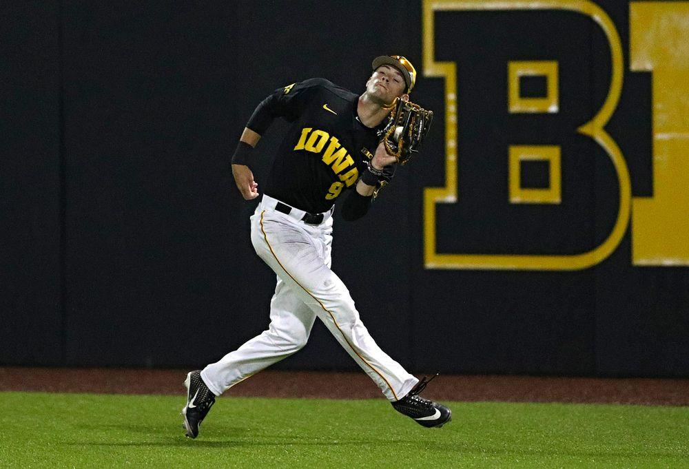 Iowa Hawkeyes right fielder Ben Norman (9) pulls in a fly ball for an out during the ninth inning of their game against Western Illinois at Duane Banks Field in Iowa City on Wednesday, May. 1, 2019. (Stephen Mally/hawkeyesports.com)