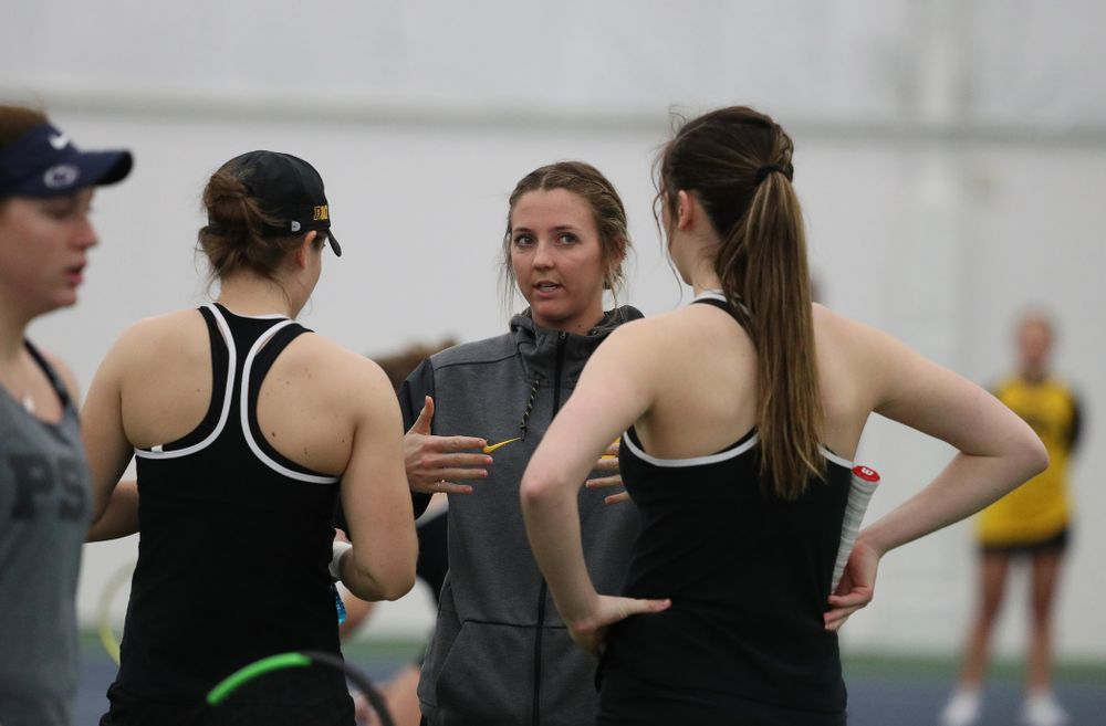Volunteer assistant coach Cassidy Spearman talks with Samantha Mannix and Elise Van Heuvelen Treadwell as they play a doubles match against the Penn State Nittany Lions Sunday, February 24, 2019 at the Hawkeye Tennis and Recreation Complex. (Brian Ray/hawkeyesports.com)
