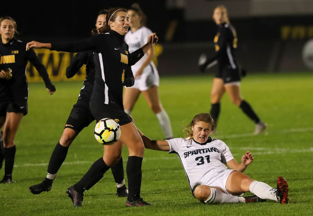 Iowa Hawkeyes forward Kaleigh Haus (4) heads the ball during a game against Michigan State at the Iowa Soccer Complex on October 12, 2018. (Tork Mason/hawkeyesports.com)