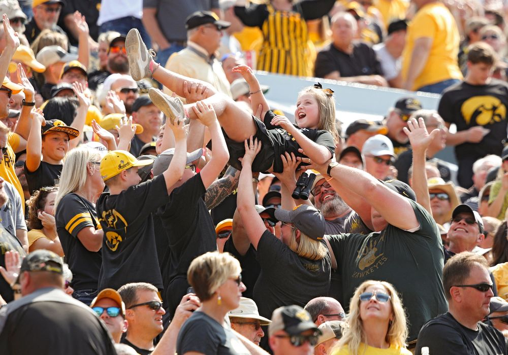 A young fan is lifted in the air during the second quarter of their Big Ten Conference football game at Kinnick Stadium in Iowa City on Saturday, Sep 7, 2019. (Stephen Mally/hawkeyesports.com)