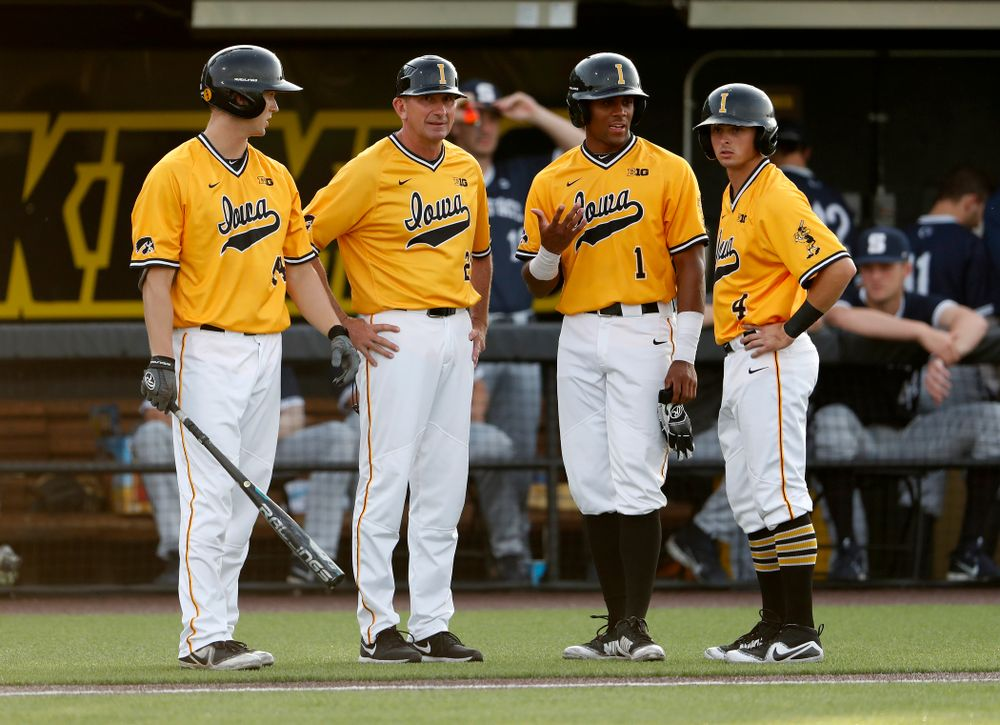 Iowa Hawkeyes outfielder Robert Neustrom (44), head coach Rick Heller, third baseman Lorenzo Elion (1), and infielder Mitchell Boe (4) against the Penn State Nittany Lions Saturday, May 19, 2018 at Duane Banks Field. (Brian Ray/hawkeyesports.com)