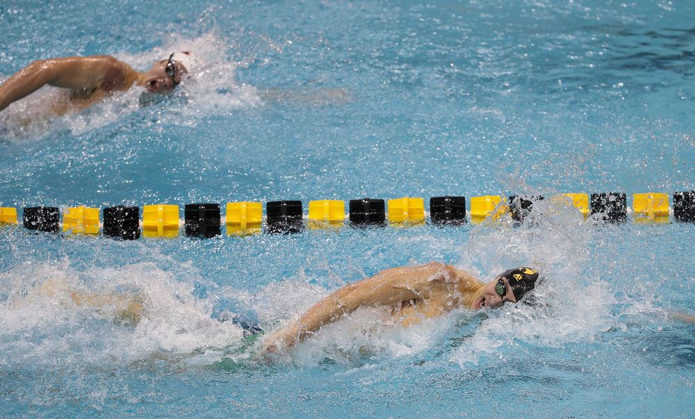 Iowa's Michael Tenney swims the anchor leg of the 800-yard freestyle relay during the third day of the Hawkeye Invitational at the Campus Recreation and Wellness Center on November 16, 2018. (Tork Mason/hawkeyesports.com)