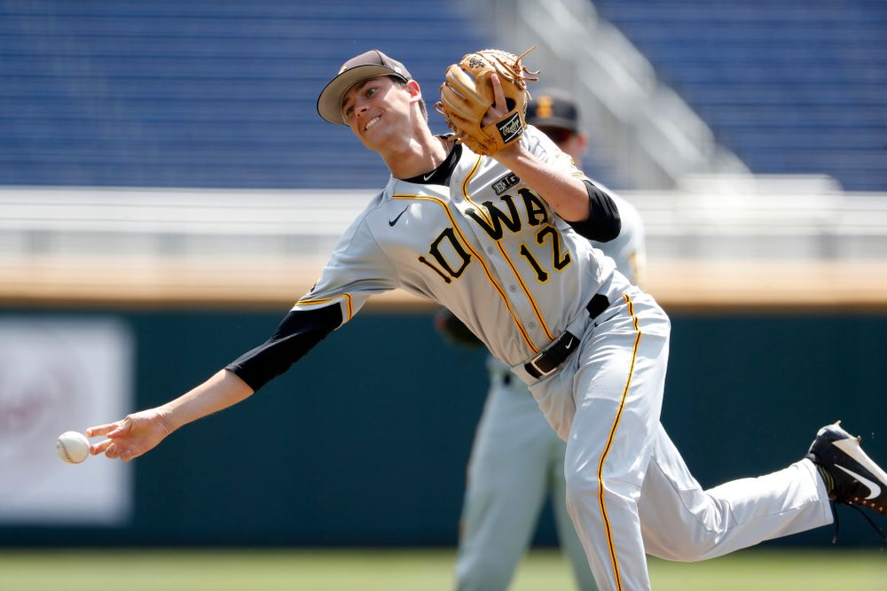 Iowa Hawkeyes pitcher Nick Nelsen (12) against the Michigan Wolverines in the first round of the Big Ten Baseball Tournament  Wednesday, May 23, 2018 at TD Ameritrade Park in Omaha, Neb. (Brian Ray/hawkeyesports.com)
