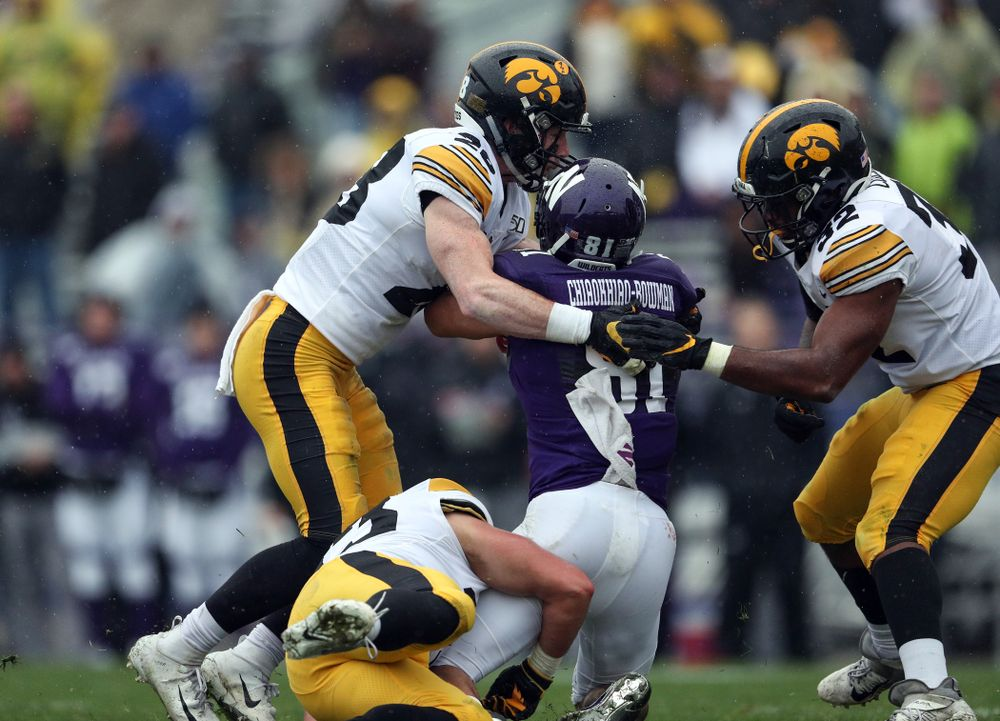 Iowa Hawkeyes defensive back Jack Koerner (28) and linebacker Djimon Colbert (32) against the Northwestern Wildcats Saturday, October 26, 2019 at Ryan Field in Evanston, Ill. (Brian Ray/hawkeyesports.com)