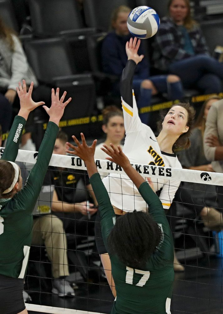 Iowa's Courtney Buzzerio (2) goes up for a kill during the first set of their volleyball match at Carver-Hawkeye Arena in Iowa City on Sunday, Oct 13, 2019. (Stephen Mally/hawkeyesports.com)
