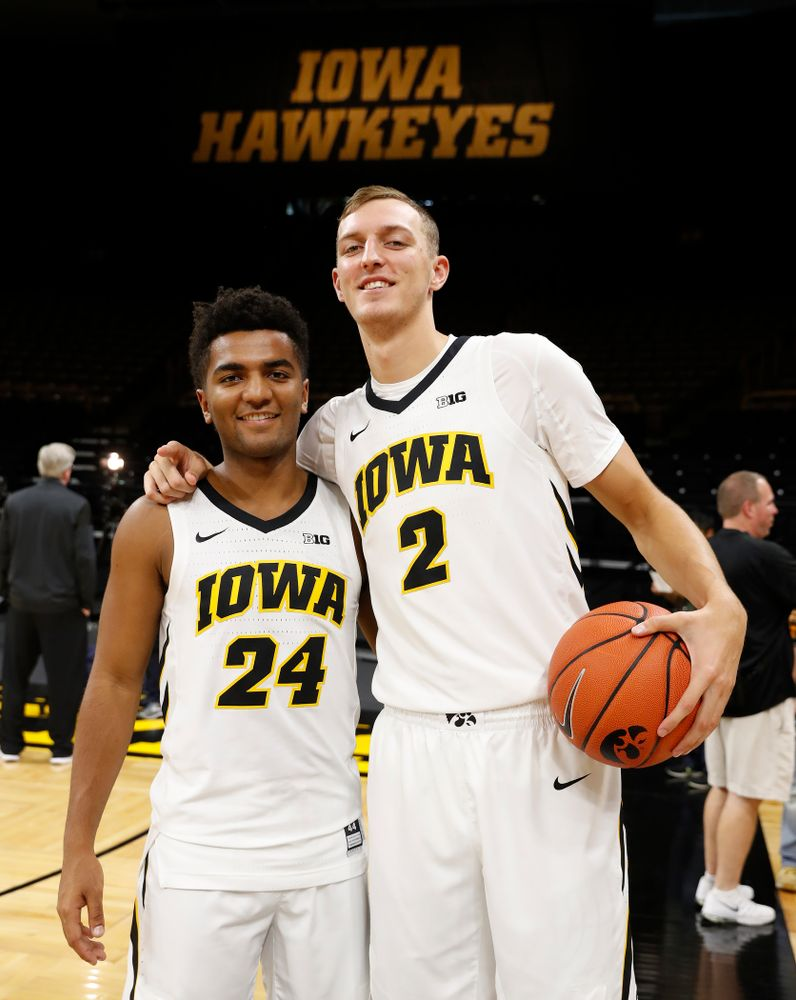 Iowa Hawkeyes guard Nicolas Hobbs (24) and forward Jack Nunge (2) during the team's annual media day Monday, October 8, 2018 at Carver-Hawkeye Arena. (Brian Ray/hawkeyesports.com)