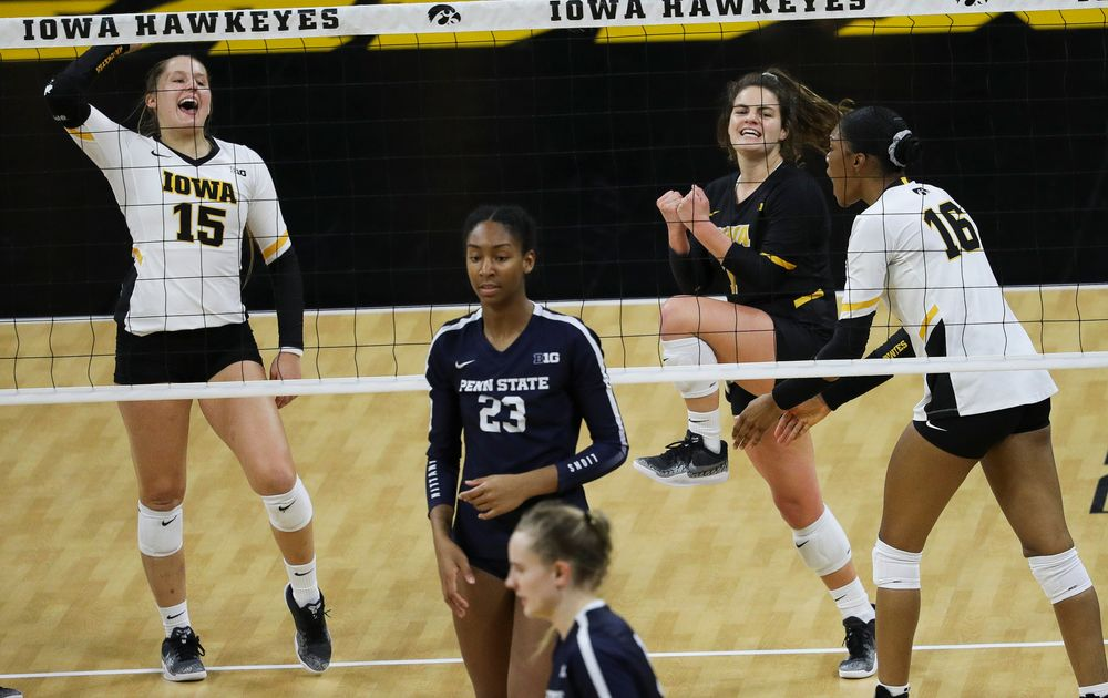 Iowa Hawkeyes defensive specialist Maddie Slagle (15) and Iowa Hawkeyes defensive specialist Molly Kelly (1) celebrate after winning a point during a match against Penn State at Carver-Hawkeye Arena on November 3, 2018. (Tork Mason/hawkeyesports.com)
