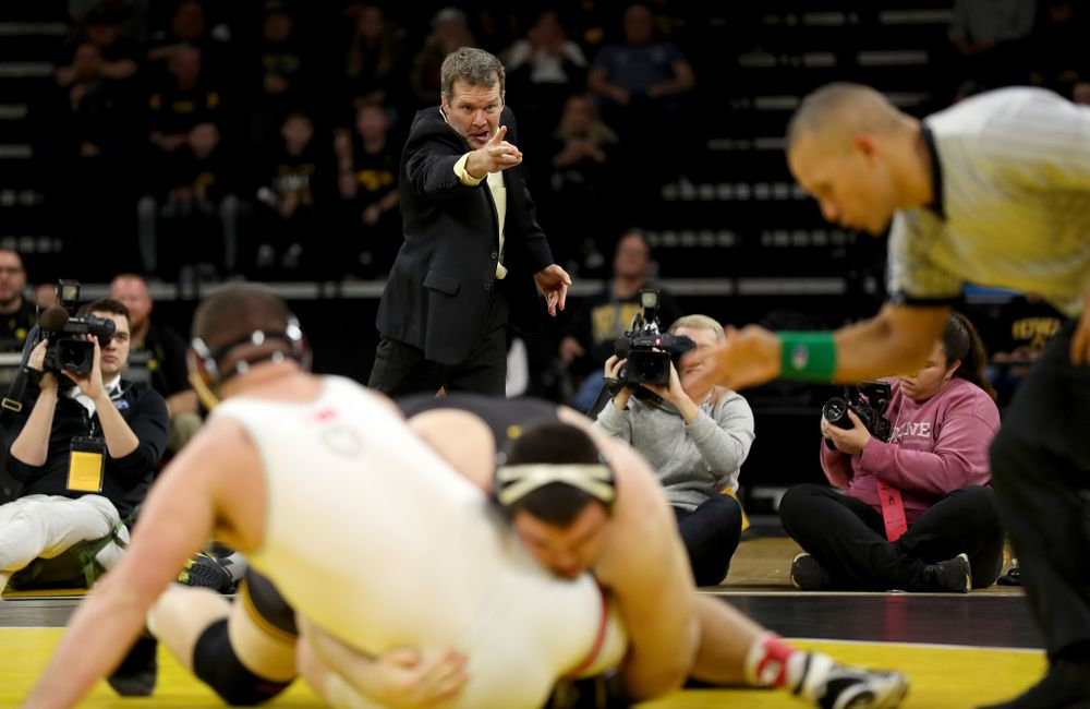 Head Coach Tom Brands works the edge of the mat as Iowa's Tony Cassioppi wrestles Ohio State's Gary Traub at heavyweight Friday, January 24, 2020 at Carver-Hawkeye Arena. Cassioppi won the match 9-3. (Brian Ray/hawkeyesports.com)