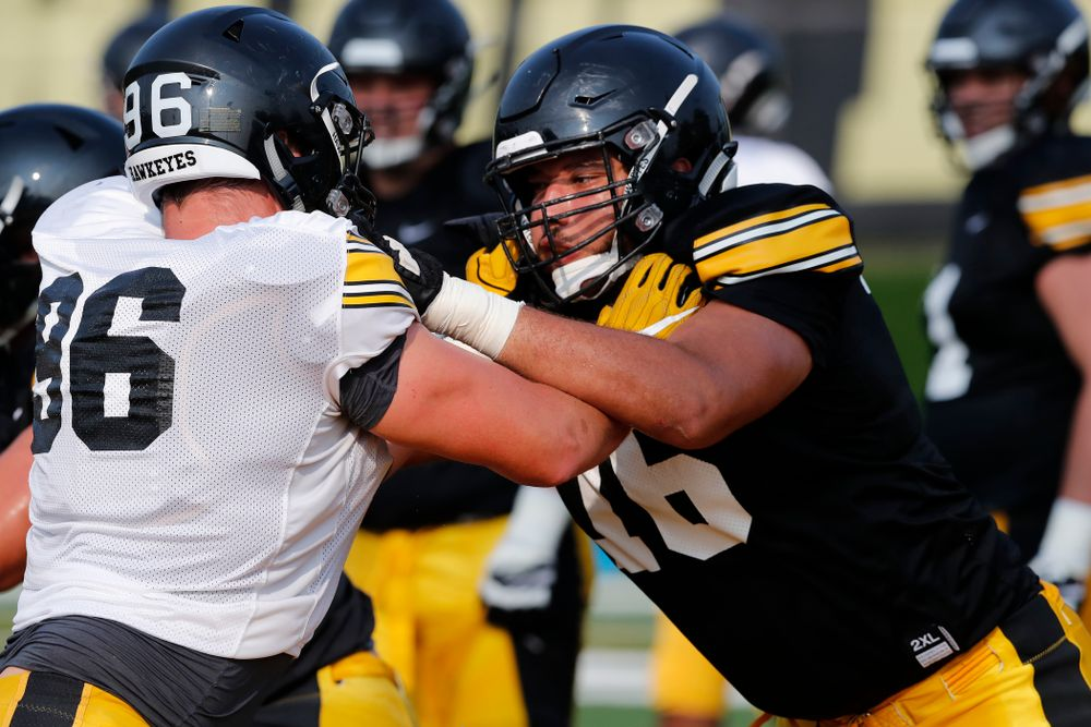 Iowa Hawkeyes offensive lineman Dalton Ferguson (76) and defensive end Matt Nelson (96) during camp practice No. 16 Tuesday, August 21, 2018 at the Hansen Football Performance Center. (Brian Ray/hawkeyesports.com)