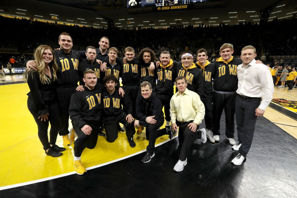 The Iowa Hawkeye seniors pose for a photo following their win over Oklahoma State on senior night Sunday, February 23, 2020 at Carver-Hawkeye Arena. (Brian Ray/hawkeyesports.com)