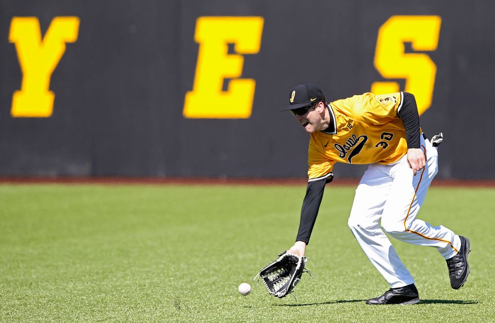 Iowa Hawkeyes Connor McCaffery (30) fields a ball during the sixth inning against Illinois at Duane Banks Field in Iowa City on Sunday, Mar. 31, 2019. (Stephen Mally/hawkeyesports.com)
