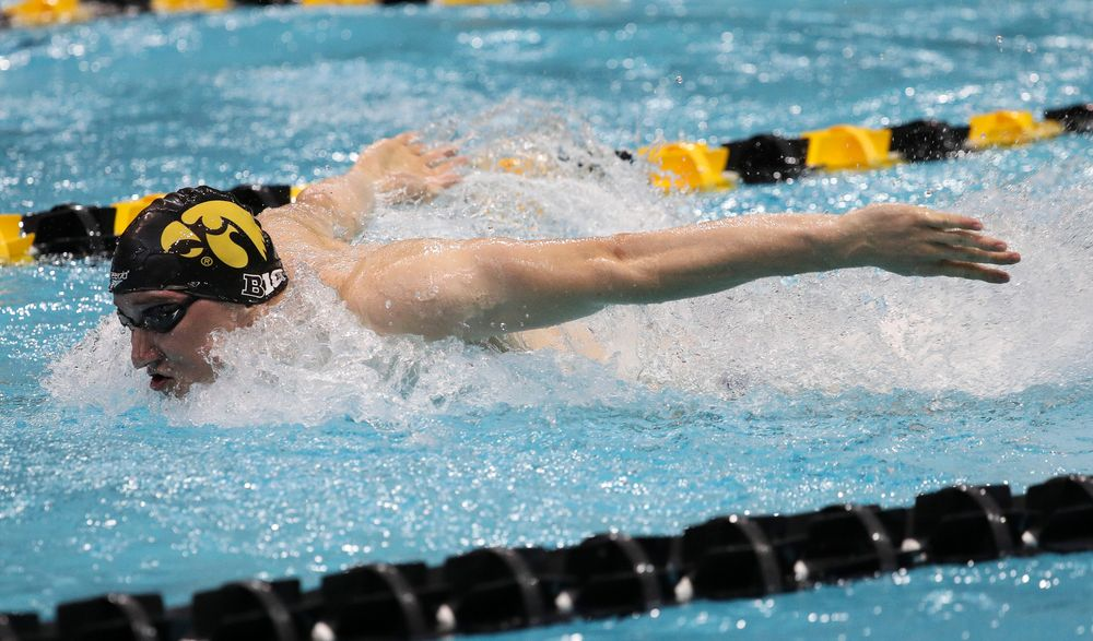 Michal Brzus competes in the 400-yard medley relay during a meet against Michigan and Denver at the Campus Recreation and Wellness Center on November 3, 2018. (Tork Mason/hawkeyesports.com)