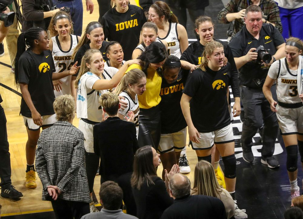 Megan Gustafson walks off the court with the Iowa Hawkeyes after her jersey retirement ceremony at Carver-Hawkeye Arena in Iowa City on Sunday, January 26, 2020. (Stephen Mally/hawkeyesports.com)