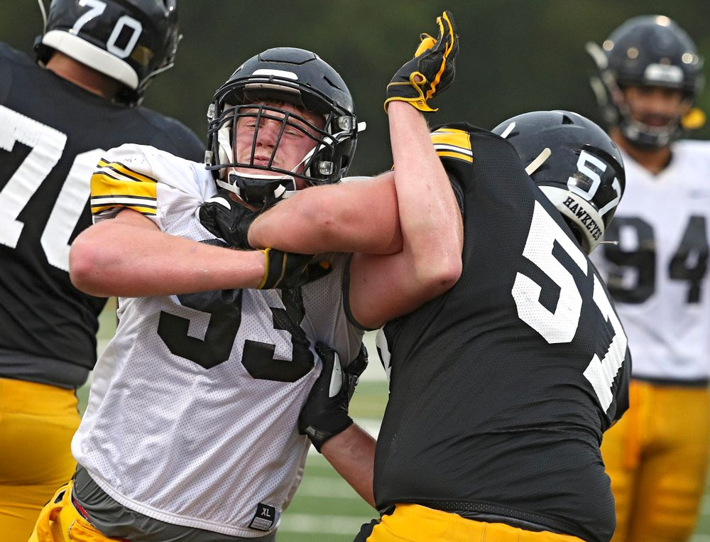 Iowa Hawkeyes defensive lineman Jake Karchinski (93) tries to get around offensive lineman Clayton Thurm (57) durning Fall Camp Practice No. 17 at the Hansen Football Performance Center in Iowa City on Wednesday, Aug 21, 2019. (Stephen Mally/hawkeyesports.com)