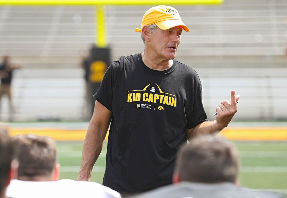 Iowa Hawkeyes head coach Kirk Ferentz talks with his team at the end of Fall Camp Practice No. 8 at Kids Day at Kinnick Stadium in Iowa City on Saturday, Aug 10, 2019. (Stephen Mally/hawkeyesports.com)