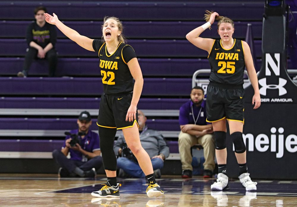 Iowa Hawkeyes guard Kathleen Doyle (22) pumps up the crowd during the first quarter of their game at Welsh-Ryan Arena in Evanston, Ill. on Sunday, January 5, 2020. (Stephen Mally/hawkeyesports.com)