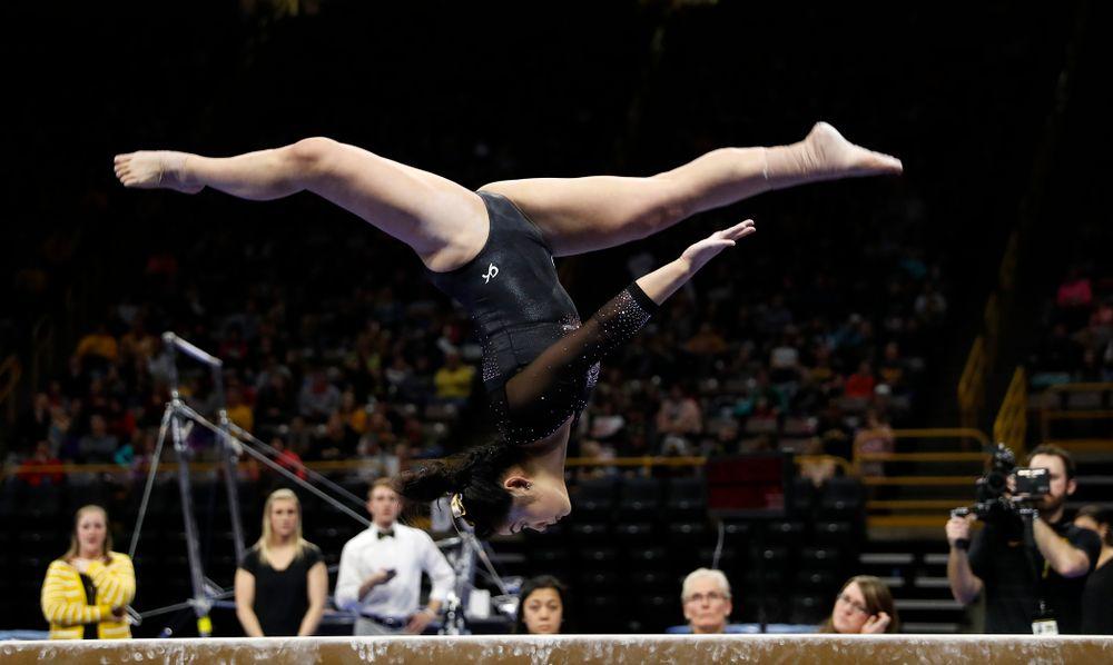 Clair Kaji competes on the beam