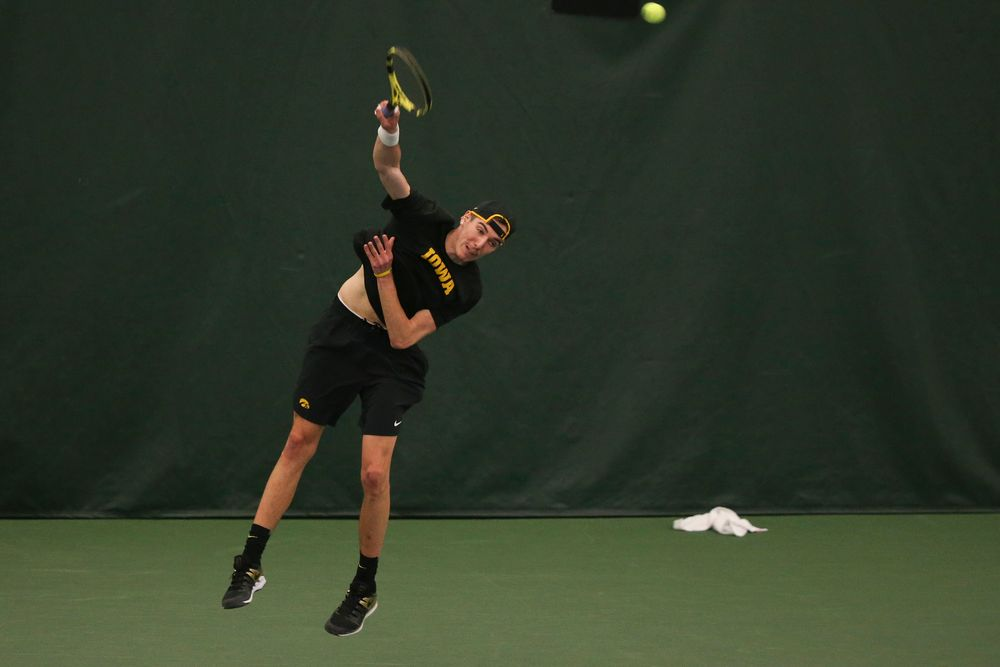 Iowa's Joe Tyler serves the ball during the Iowa men's tennis meet vs VCU  on Saturday, February 29, 2020 at the Hawkeye Tennis and Recreation Complex. (Lily Smith/hawkeyesports.com)