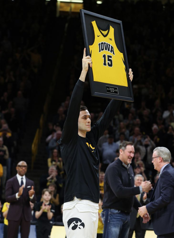 Iowa Hawkeyes forward Ryan Kriener (15) hold up his jersey during senior night activities before their game against the Purdue Boilermakers Tuesday, March 3, 2020 at Carver-Hawkeye Arena. (Brian Ray/hawkeyesports.com)