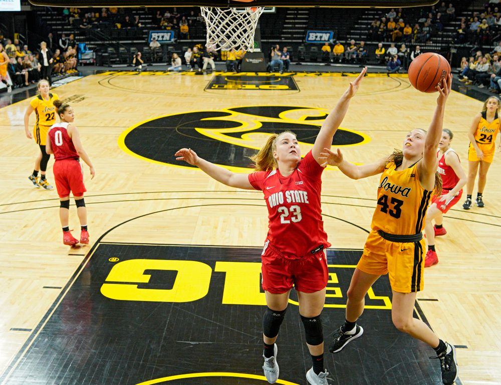 Iowa Hawkeyes forward Amanda Ollinger (43) scores a basket during the first quarter of their game at Carver-Hawkeye Arena in Iowa City on Thursday, January 23, 2020. (Stephen Mally/hawkeyesports.com)