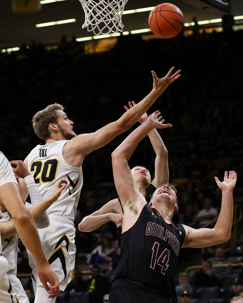 Iowa Hawkeyes forward Riley Till (20) goes up for a rebound during a game against Guilford College at Carver-Hawkeye Arena on November 4, 2018. (Tork Mason/hawkeyesports.com)