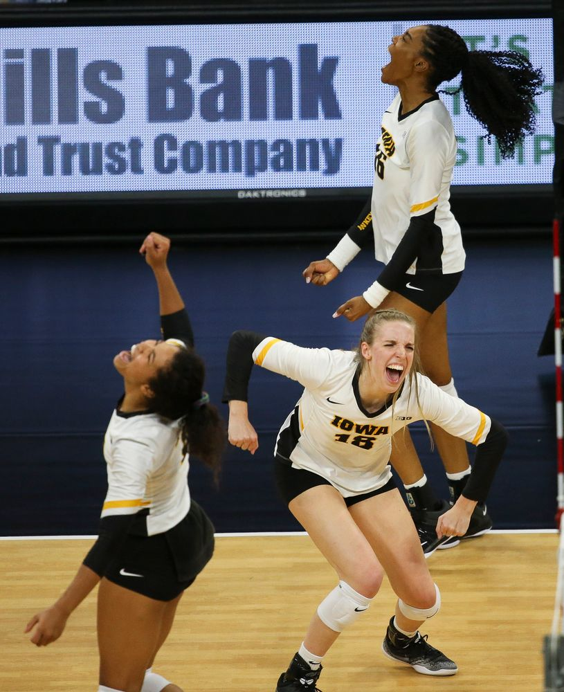 Iowa Hawkeyes middle blocker Hannah Clayton (18) and Iowa Hawkeyes outside hitter Taylor Louis (16) react after winning a point during a game against Purdue at Carver-Hawkeye Arena on October 13, 2018. (Tork Mason/hawkeyesports.com)