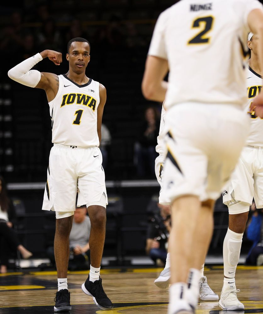 Iowa Hawkeyes guard Maishe Dailey (1) flexes to Iowa Hawkeyes forward Jack Nunge (2) after Nunge's first half dunk during a game against Guilford College at Carver-Hawkeye Arena on November 4, 2018. (Tork Mason/hawkeyesports.com)