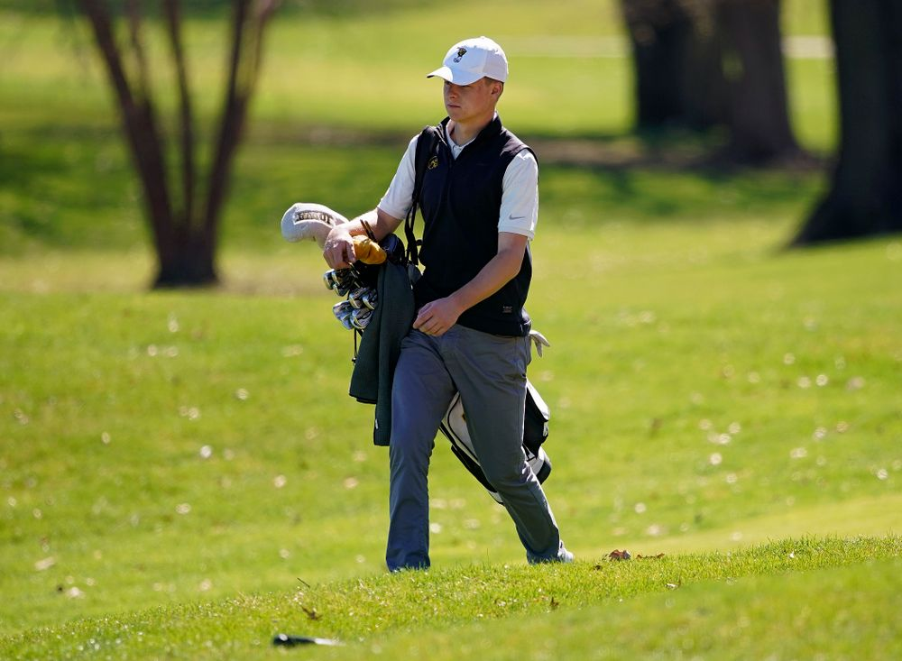 Iowa's Benton Weinberg walks between holes during the first round of the Hawkeye Invitational at Finkbine Golf Course in Iowa City on Saturday, Apr. 20, 2019. (Stephen Mally/hawkeyesports.com)