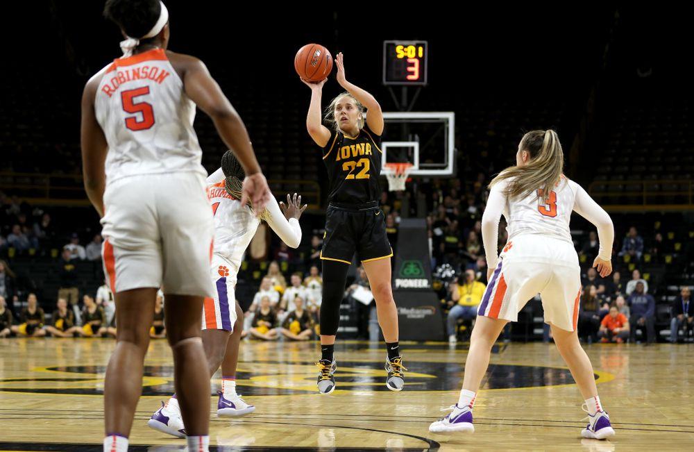 Iowa Hawkeyes guard Kathleen Doyle (22) knocks down a three point basket against Clemson Wednesday, December 4, 2019 at Carver-Hawkeye Arena. (Brian Ray/hawkeyesports.com)