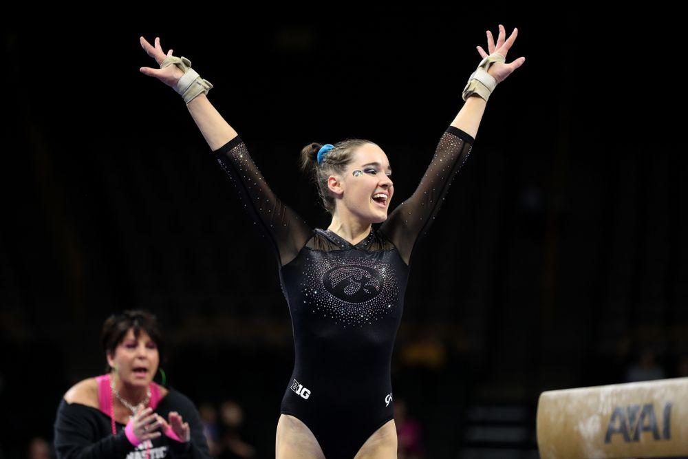 Iowa's Allie Gilchrist competes on the beam against Michigan Friday, February 14, 2020 at Carver-Hawkeye Arena. (Brian Ray/hawkeyesports.com)