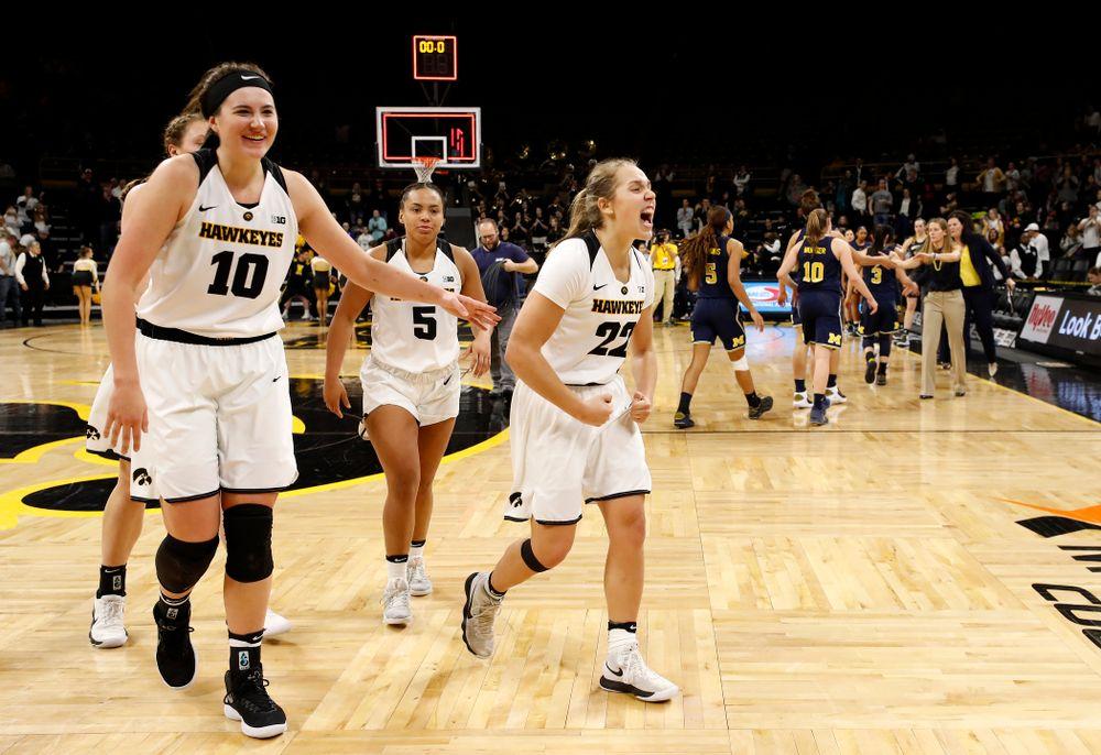 Iowa Hawkeyes guard Kathleen Doyle (22) and forward Megan Gustafson (10)