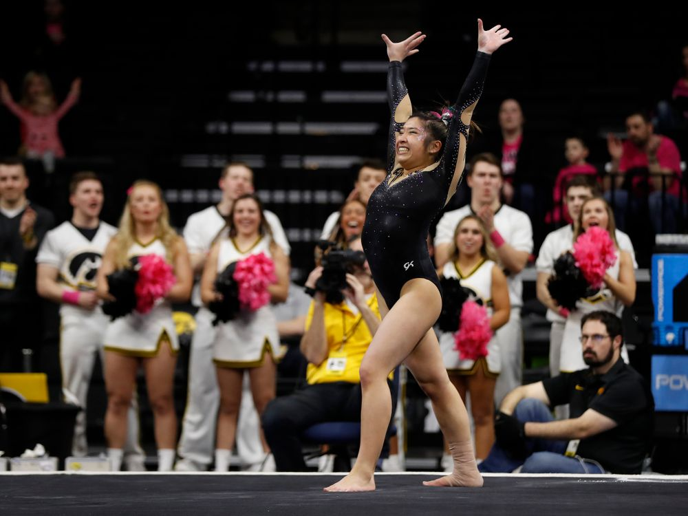 Iowa's Nicole Chow competes on the floor