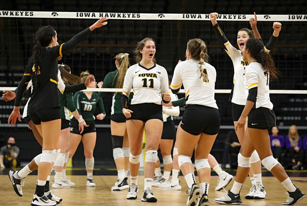Iowa's Halle Johnston (4), Griere Hughes (10), Blythe Rients (11), Joslyn Boyer (1), Courtney Buzzerio (2), and Brie Orr (7) celebrate a score during the second set of their volleyball match at Carver-Hawkeye Arena in Iowa City on Sunday, Oct 13, 2019. (Stephen Mally/hawkeyesports.com)