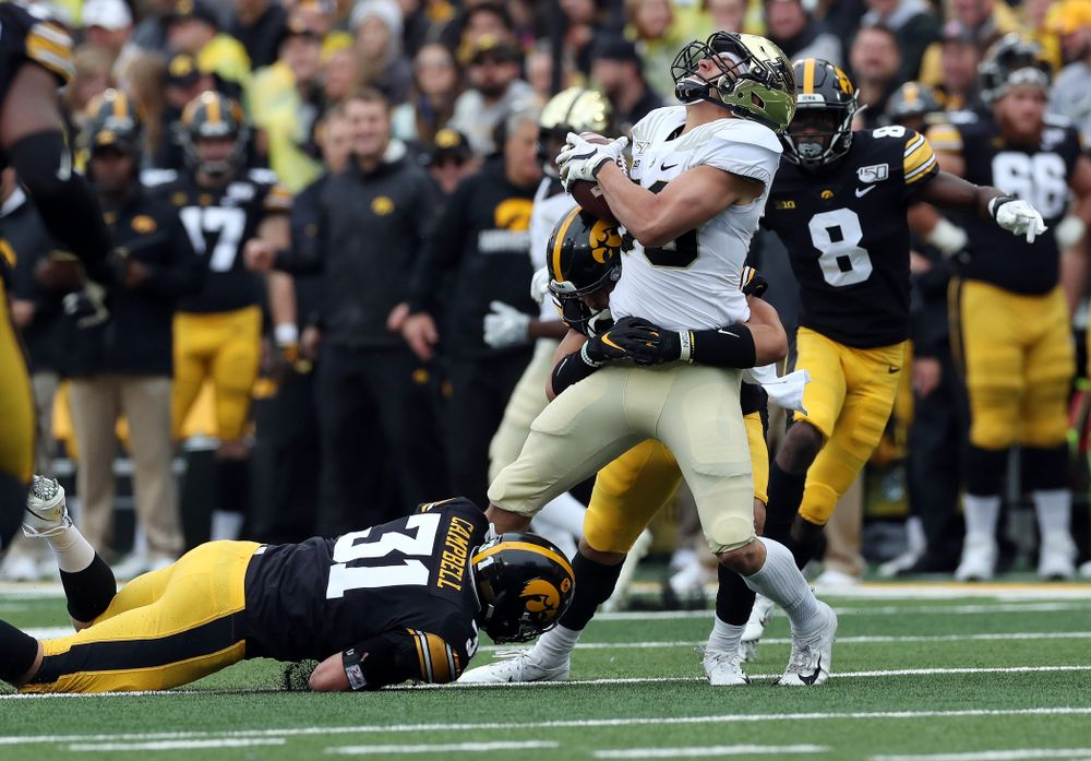 Iowa Hawkeyes defensive back Dane Belton (4) and linebacker Jack Campbell (31) against the Purdue Boilermakers Saturday, October 19, 2019 at Kinnick Stadium. (Brian Ray/hawkeyesports.com)