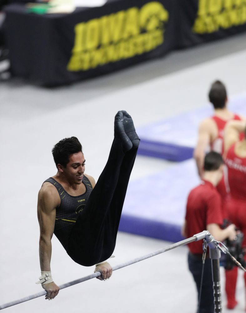 Iowa's Andrew Herrador competes on the high bar against Oklahoma Saturday, February 9, 2019 at Carver-Hawkeye Arena. (Brian Ray/hawkeyesports.com)